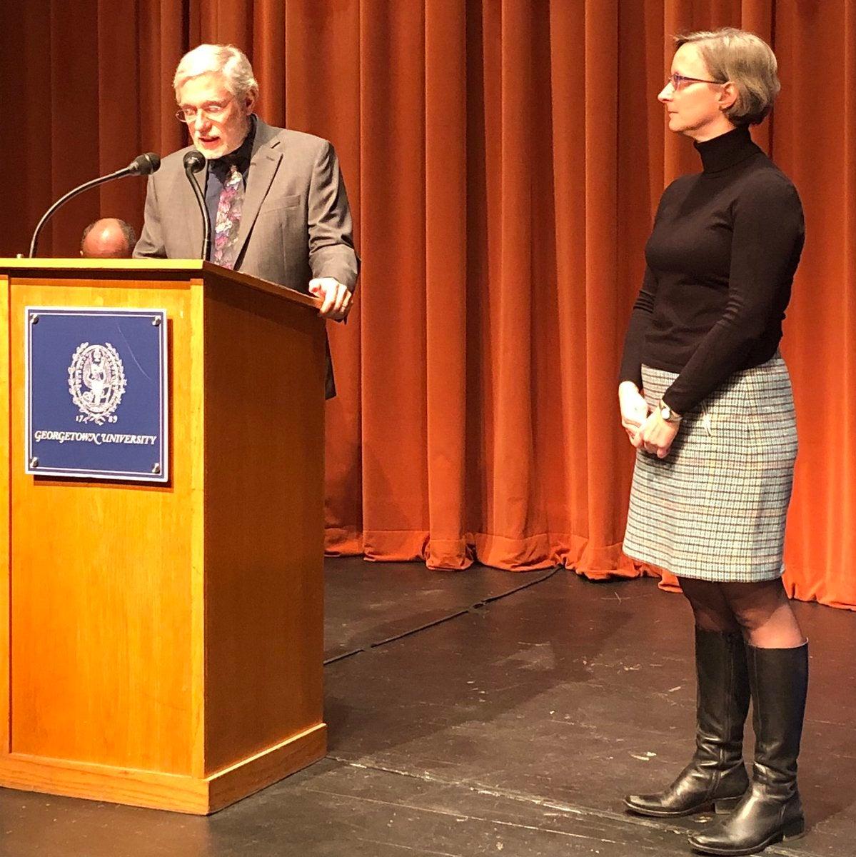 Jennifer Fox receives an award from the Biology Chair Mark Rose